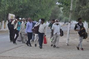Followers leaving the Dera Sacha Sauda headquarters in Sirsa after they were evicted on August 29.