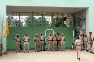 Policemen outside the Salabatpura centre of Dera Sacha Sauda in Bathinda.