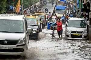 Vehicles ply on a waterlogged road after heavy rains left Mumbai submerged on Wednesday.