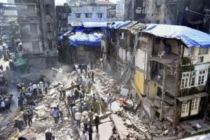 Rescue work in progress after a five storey building collapsed in Bhendi bazaar in Mumbai on Thursday.