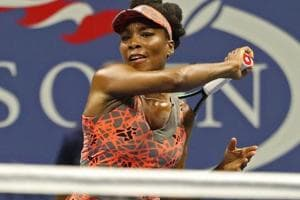 Venus Williams hits a forehand against Oceane Dodin at the US Open.
