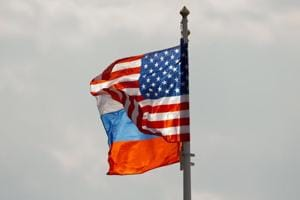 US and Russian national flags wave on the wind before US Secretary of State Rex Tillerson