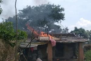 One of the three houses of a Muslim man in Naitand village in Jharkhand's Giridh district set ablaze by a mob after he allegedly slaughtered cows on Saturday.
