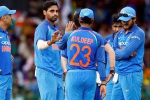 Bhuvneshwar Kumar celebrates with Indian cricket teammates after taking the wicket of Sri Lanka