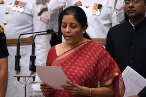 Nirmala Sitharaman takes the oath during the swearing-in ceremony in New Delhi onSunday .