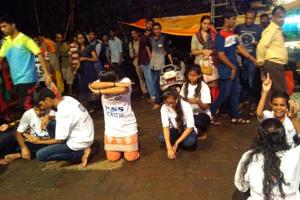 Students from MD College perform a street play at a pandal in Mumbai.