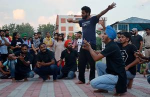 Poll ready: SFS members performing a street play in Panjab University in Chandigarh on Sunday.