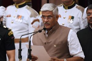 Bhartiya Janata Party politician Gajendra Singh Shekhawat takes oath during the swearing-in ceremony of new ministers at the Presidential Palace in New Delhi on Sunday.