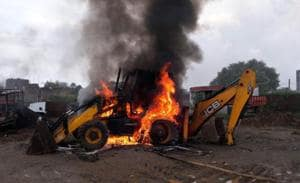 One of the JCB machines that was set on fire by an irate mob in Patna on Tuesday.