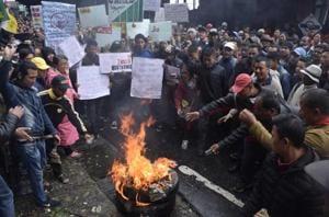 GJM supporters burning mobile phones in Darjeeling in protest against suspension of internet services.