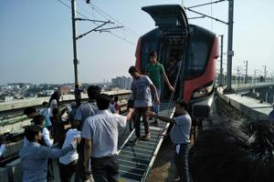 Passengers being taken out of the emergency exit after a Lucknow Metro train developed a snag on Wednesday. (HTphoto)