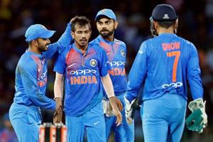 Virat Kohli celebrates with Yuzvendra Chahal after the fall of a Sri Lanka batsman in the one-off T20.
