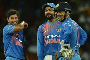 Kuldeep Yadav, Virat Kohli and MS Dhoni celebrate the dismissal of a Sri Lankan batsman during the one-off T20 in Colombo.