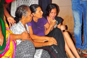 Family members mourn the death of journalist Gauri Lankesh, who was shot dead at her residence in Bengaluru on Tuesday night.