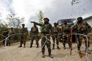 File photo of Indian Army soldiers standing guard at their base after it was attacked by militants in Kashmir
