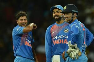 Indian cricket team's Kuldeep Yadav (left)celebrates with Virat Kohli and MS Dhoni after taking the wicket of Sri Lanka cricket team