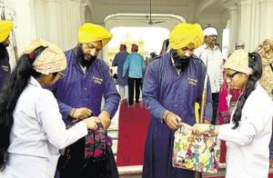 Members of the SGPC task force checking bags of devotees at the entrance to the Golden Temple in Amritsar on Wednesday.