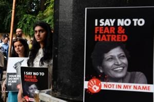Demonstrators hold placards with the photograph of Gauri Lankesh during a