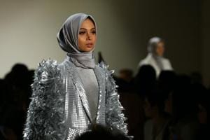 "Two of the five fell into the category ""modest fashion"" -- in this instance designed specifically for the affluent, modern, religiously observant Muslim woman -- and featured models all of whom covered their hair Islamic style."