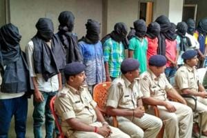 Arrested gang-rape accused standing in a row in Dumka