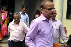 CBIofficials escorting income tax officer during production before a special CBI court in Ranchi