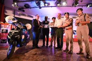 Traffic volunteer Mukul Chandra Joshi being felicitated by the police on Saturday.