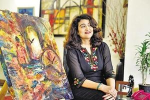 Alpana Kataria with her paintings at her residence in Gurgaon. (Sanjeev Verma / HT photo)