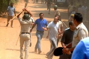 Police resort to lathcharge to control protesters near Ryan International School in Gurgaon on Sunday.