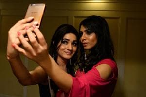 Finalists of Miss Transqueen 2017 take selfies backstage before the beauty pageant for trangender people in Gurgaon.