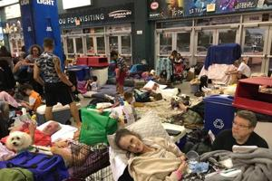 Florida residents take shelter from Hurricane Irma inside the Germain Arena in Estero.