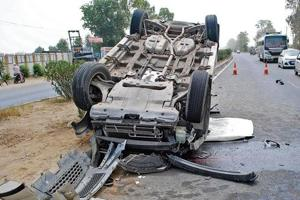 A car that overturned after hitting a tractor from the rear at Manawala village, 8km from Amritsar on June 12, 2016. According to the data compiled by the transport research wing of the Union road transport and highways ministry, as many as 102 persons were killed in 152 accidents in the city last year.