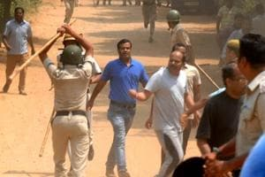 Police used lathis to control protesters who set fire to a liquor shop near Ryan International School, in Gurgaon on Sunday.
