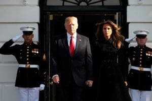 US President Donald Trump and first lady Melania Trump arrive to observe a moment of silence in remembrance of those lost in the 9/11 attacks at the White House in Washington.
