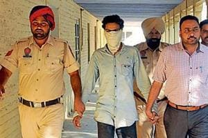 The accused in police custody in Jalandhar on Monday.