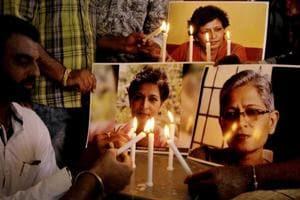 People hold a demonstration to protest the killing of Gauri Lankesh, a senior Kannada journalist, in Amritsar onSeptember 8.