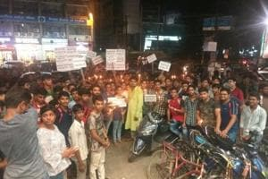 Students protest the decision to make the IIT-JEE Advanced exam online from next year, in Patna, on Saturday.