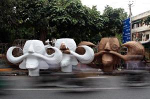 A shot of the Raavan effigies in the making at Titarpur village in the Capital.