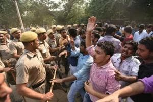 NSUI supporters clash with the police demanding recounting for votes for joint secretary seat.