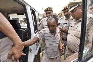 Ashok Kumar is accused of slitting the boy's throat twice inside a school toilet with a knife that he had carried with him.