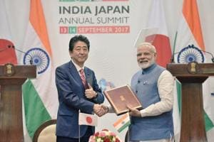 Prime Minister Narendra Modi and his Japanese counterpart Shinzo Abe shake hands after signing agreements between the two countries on Thursday.