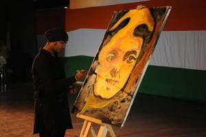 Artist AS Gulati painting a sketch of Indira Gandhi on the occasion.