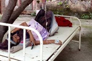A resident of Beora, Pooja Tapala was brought to a government civil hospital after she developed some complications on Wednesday. She was then placed on a bed under a tree outside as there were no beds available inside.