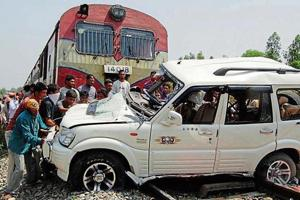 Villagers trying to clear the track after an SUV collided with a train at Parjian village of Sultanpur in April 2011. The division has reported four deaths due to unmanned crossings in the past two years.