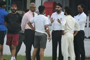 Suresh Raina, India Red captain, and Dinesh Karthik, India Blue captain, talks with the umpires during their Duleep Trophy.