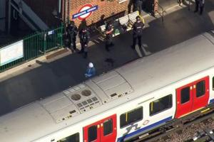 In this aerial image made from video, police officers work at the Parsons Green Underground station after an explosion in London on Friday.