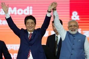 Japanese Prime Minister Shinzo Abe (L) with Indian counterpart Narendra Modi after the groundbreaking ceremony for a high-peed rail project in Ahmedabad on Thursday.