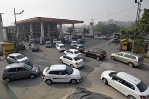 Vehicles in front of a petrol pump in New Delhi.