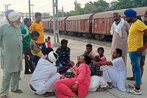 Farmers negotiating wages with labourers at the Mansa railway station on Friday.