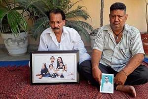 Family members holding the pictures of deceased Lalit and his missing uncle Talwinder Singh in SBSNagar on Friday.