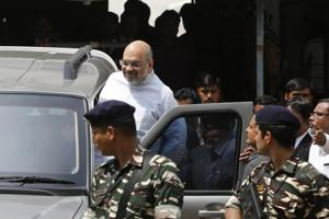 Bharatiya Janata Party president Amit Shah leaves after appearing before a special sessions court in Ahmedabad on Monday.